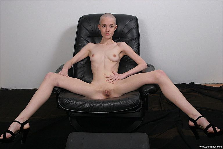 ThinFetish.com - Kate is naked on a leather chair Slide ...